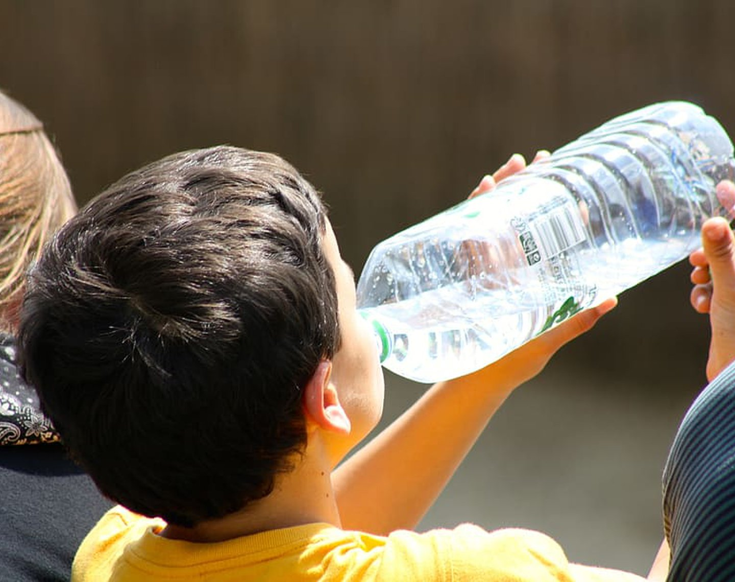 boy-drinking-from-bottle-child-drinking-water-thirsty-boy-drinking.jpg